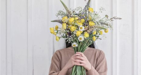 woman-holding-wild-yellow-flower-bouquet-picture-id1155480800 (1)